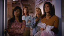 The four central housewives peer out onto their home street, Wisteria Lane.