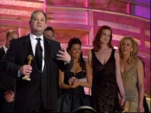 "Marc Cherry accepts a Golden Globe in front of his leading ladies, as seen in the featurette ""Desperate Housewives Around the World."""