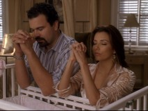 Gabrielle and Carlos settle down for a prayer in one of the set's deleted scenes.