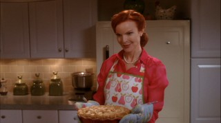 Bree (Marcia Cross) poses for the cover of her cookbook, the success of which takes her to a new station in life in Season Five.