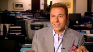 "David Walliams, who plays the tan Swiss millionaire Martin Mueller in the film, sings the praises of craft services in ""The Biggest Schmucks in the World."""
