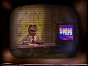 "Television is a regular staple of life on ""Dinosaurs"", and so DNN correspondent Howard Handupme is regularly the Sinclairs' link to the outside world."