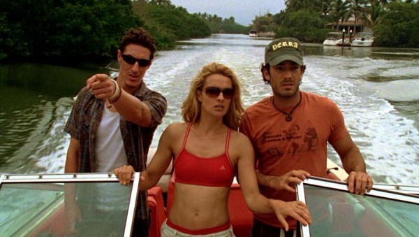 "Trace (Eric Balfour), Carol (Iva Hasperger, showing off her toned abdomen), and Luis (Aarón Díaz) search for the prehistoric ""Dinoshark"" that ate their friend."