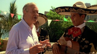 Dr. Frank Reeves (legendary B-movie producer Roger Corman) enjoys the mariachi band, but not the volume at which they're playing for the marina fiesta.
