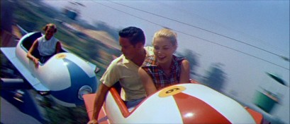 "This sporty young couple of the 1950s flies high in the Astro-Jets of Tomorrowland (the Astro Orbiter today) in ""People and Places: Disneyland U.S.A."""