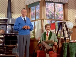 "Walt interacts with the audio-animatronic father who stars in his Carousel of Progress attraction in ""Disneyland Goes to the World's Fair."" (Psst... Mr. Rogers called. He wants his sweater back.)"