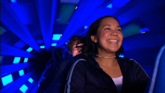 This Space Mountain rider is all smiles to be moving through the ride's energizing tunnel of blue light.