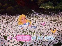 "Alice sings ""In A World Of My Own"" while reclining in a bed of daisies."