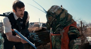 Multi-National United assigns Wikus van de Merwe (Sharlto Copley) to serve District 9's aliens with eviction notices like this.