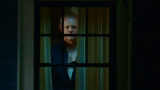 Here's something you don't want to see in spying on your neighbors: the creepy Mr. Turner (David Morse) stares back at his uneasy audience.