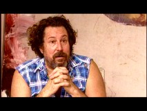"Director Julian Schnabel looks the part of an unkempt painter in the most ordinary featurette, ""Submerged."""