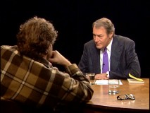 Months before a MacBook beat him up, Charlie Rose listened intently to director Julian Schnabel in a lumberjack's coat.