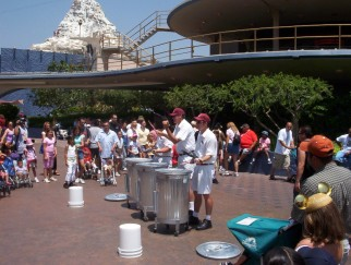 These silly Tomorrowland garbagemen turn their work into street music.