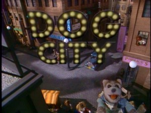 "The title logo appears in lights as the residents of Dog City sing the titular theme song ""Dog City."""
