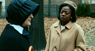 Sr. Aloysius walks and talks with Mrs. Miller (Viola Davis), who responds unexpectedly to the things she's told.