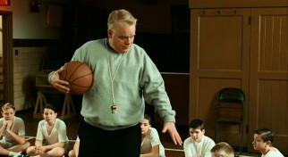 Father Flynn (Philip Seymour Hoffman) shows the students on the school basketball team his clean fingernails. He likes to keep them a little long.