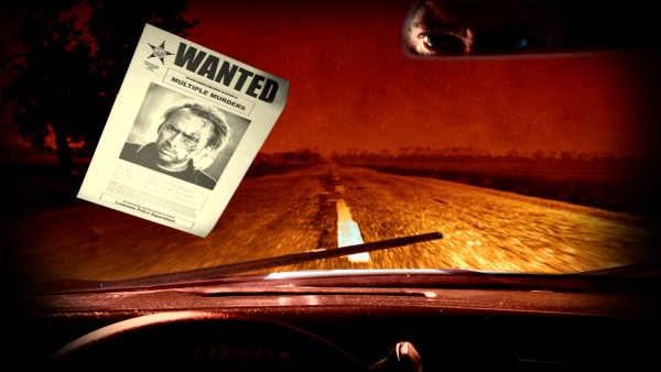 A wanted sign for Milton in the state of Louisiana hits the windshield of a car, whose rearview mirror reflection reveals is clearly driven by the Nicolas Cage character in the first-person dashboard view of the Blu-ray menu adapted from the film's closing credits.