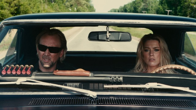 "Hell escapee John Milton (Nicolas Cage) and young waitress Piper (Amber Heard) are unlikely companions on a road trip through America's heartland in ""Drive Angry."""