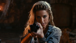 Piper (Amber Heard) aims the GodKiller gun right at the camera in one of the film's many shots designed for 3D effect.