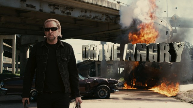 John Milton (Nicolas Cage) gives a badass slow walk away from destruction in the early shot displaying the film's 3D-minded title logo.