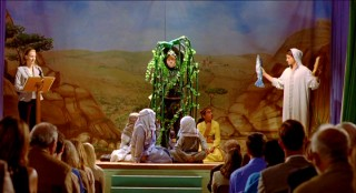 Ben is in the middle of his mother's church play, portraying a tree at the scene of Jesus multiplying loaves and fish.