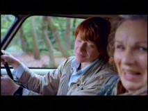 Rupert Grint and Julie Walters share a bit of a laugh over a flub in the Outtakes reel.