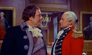 King George III (Eric Pohlmann) expresses his displeasure in General Pugh's (Geoffrey Keen) unsuccessful efforts to nab the Scarecrow.