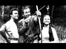 "Walt Disney plays with a bow and arrow on the set of his 1950s Robin Hood film in ""From Burbank to London."""