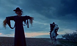 Dr. Syn rides past a scarecrow in the most iconic, repeated, and reversed shot of the series.