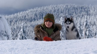 "Adam smiles with his trusty husky Shasta (voiced by ""Suite Life of Zack & Cody"" star Dylan Sprouse) by his side."