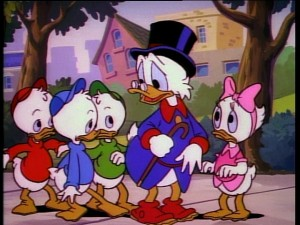 From left to right: Huey, Louie, Dewey, Scrooge, and Webby put their heads together.