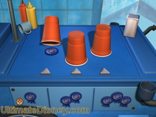 The player is asked to risk 1-3 of their ribbons. The cups will then shuffle and if the player chooses the one with the treat under it, the player get as many ribbons as they had risked.