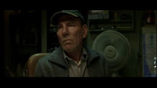 The apartment building super is as creepy as Pete Postlethwaite!