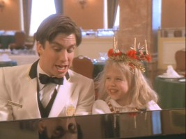 Bill and Eloise have fun singing Christmas songs together at the piano.