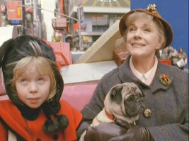 On their big shopping day, Eloise and Nanny take a ride through Manhattan in a horse-drawn carriage.