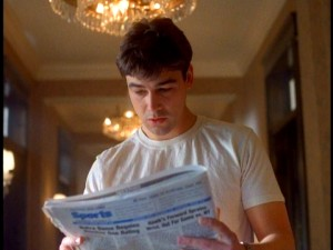 "Gary Hobson (Kyle Chandler) takes a close look at tomorrow's newspaper, which he receives for the second of many times on ""Early Edition."""