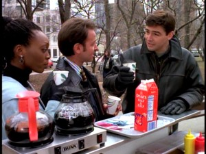 Gary has a coffee cart chat with his two closest friends, Marissa Clark (Shanesia Davis) and Chuck Fishman (Fisher Stevens).