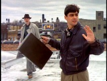 Atop the roof of a bank, Gary obeys the pilot episode's would-be robber (Tom Noonan).