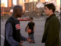 "High school basketball star Michael Williams (Sharrieff Pugh) and all-knowing concerned citizen share a playground exchange in ""Hoops."""