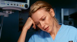 "London midwife Anna (Naomi Watts) cries over the baby whose fate is in question in ""Eastern Promises."""