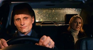 "With tattoos by his knuckles, Nikolai (Viggo Mortensen) the ""driver"" gives Anna a ride home."