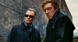 Shaded, smoking Nikolai and the coarse Kirill (Vincent Cassel) give off a gangster look having just disposed of a foe.