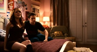 Olive (Emma Stone) and gay classmate Brandon (Dan Byrd) create a reputation-changing scene at Melody Bostic's party with the amorous bedroom sounds they emit.