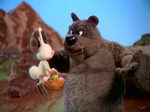 "Gadzooks, the big brown bear of Big Rock Mountain, stops Sunny from passing with a basket of ""colored stones."""