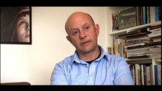 "With the boy of ""About a Boy"" peeking out from a wall poster, Nick Hornby discusses a film for which he actually wrote the screenplay in ""The Making of 'An Education'."""