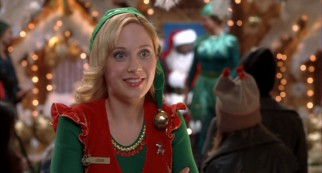 Jaded department store elf Jovie (Zooey Deschanel) assumes love interest duties.