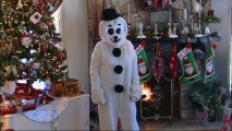 "Proving that eccentricity is key to Christmas displays, Deb Gorgens stays in this snowman outfit for the entirety of her ""Deck the Halls"" segment."