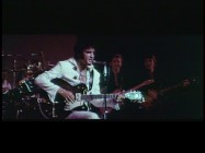 "While it may not seem special to people have bought unauthorized 12-disc collections, Disc 2 provides 37 minutes of outtakes that show Elvis in footage shot for the film but unused. Here, Elvis sits, plays guitar, and sings ""Little Sister"" all at once."