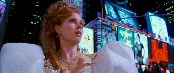 The newly-human Giselle (Amy Adams) gets her first look at our world, having just entered the middle of Manhattan through a sewer. As in many parts, the viewer can find meaning (intended or not) in several of the Times Square billboards. Mamma Mia!