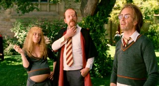 Harry Potter (Kevin McDonald) is old, Ron Weasley (George Alvarez) is mustachioed, and Hermoine (sic, Crista Flanagan) is pregnant in this version of Hogwarts.